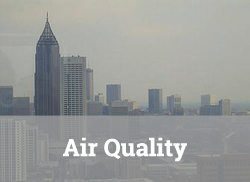 "Hazy view of Atlanta skyline with text overlay, ""Air Quality."""